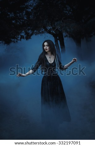 fashionable toning,creative computer colors,On the eve of Hello ween  mystical witch to conjure and decided to cook a potion in the tank, wades through the veil of fog - stock photo