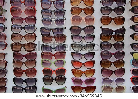 Fashionable, trendy and colorful sunglasses on display - stock photo