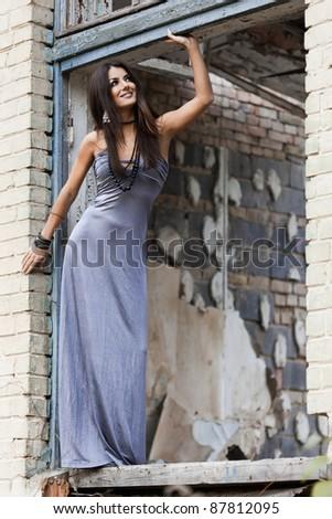 fashionable woman at the grunge window - stock photo