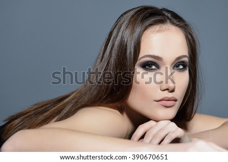 Fashionable woman. Beautiful female face. Woman of high society. Heartbreaker. Beauty woman. Portrait of amazing young fashion woman posing at studio. - stock photo