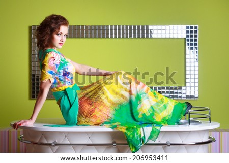 fashionable woman in a autumn color in light background - stock photo