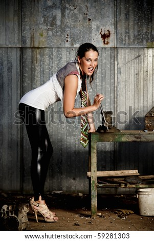 Fashionable woman in a workshop - stock photo