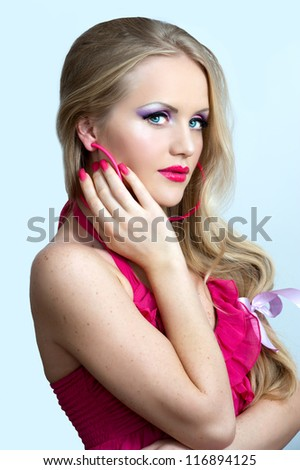 fashionable woman in pink dress