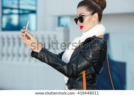 Fashionable woman outdoors portrait, Fashion model in leather jacket, beautiful lady with dark hair wearing elegant clothes - stock photo