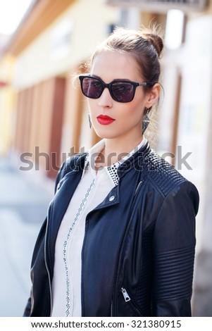 Fashionable woman posing at street, urban fashion - stock photo