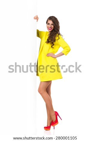 Fashionable Woman Posing with Big White Banner. Full length isolated on white. - stock photo