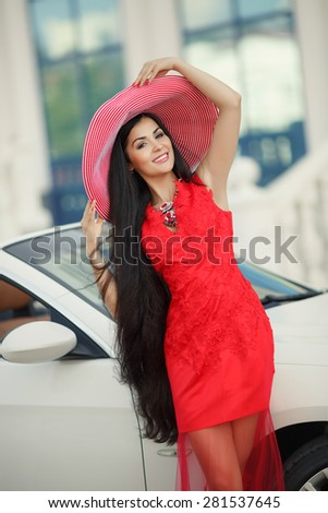 Fashionable woman smiling in car beautiful young girl portrait summer vogue female driver, sexy fashion woman model in luxury car, series - stock photo