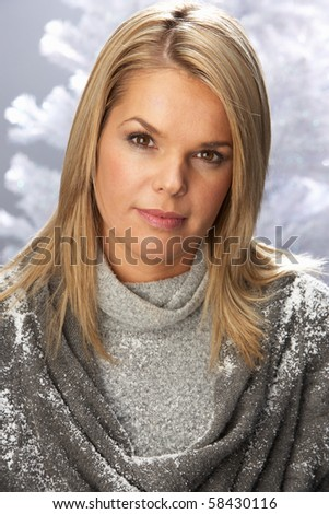 Fashionable Woman Wearing Knitwear In Studio In Front Of Christmas Tree - stock photo