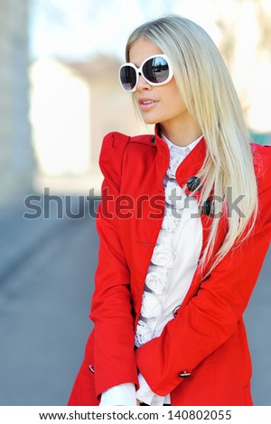Fashionable woman wearing sunglasses outdoors