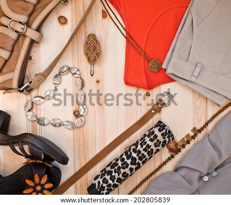 fashionable women's clothing and accessories in beige tones - stock photo