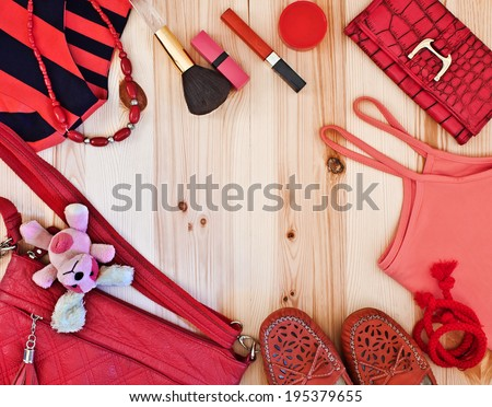 fashionable women's clothing and accessories in red tones - stock photo