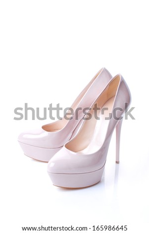 Fashionable women's high-heeled shoes isolated on white background