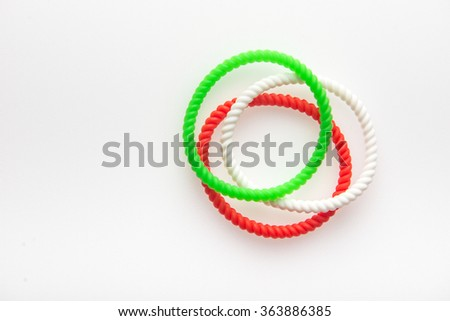 Fashionable wrist bands in Indian flag tricolors. Isolated image. - stock photo