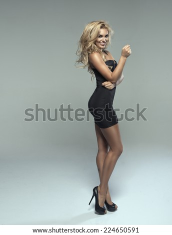 Fashionable young blonde sensual woman  - stock photo