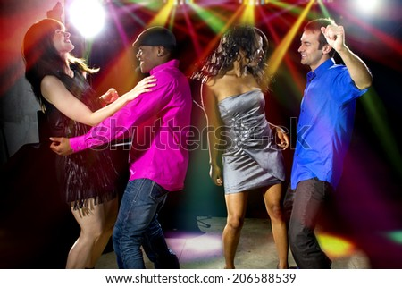 fashionable young male and female adults club dancing