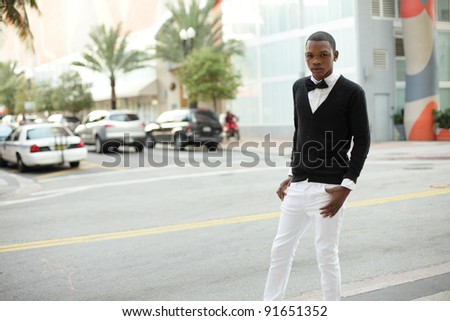 Fashionable young man posing on the streets of Downtown Miami