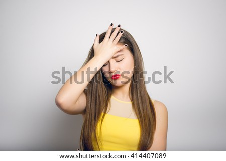 Fashionable young woman made a mistake, in yellow close-up isolated - stock photo