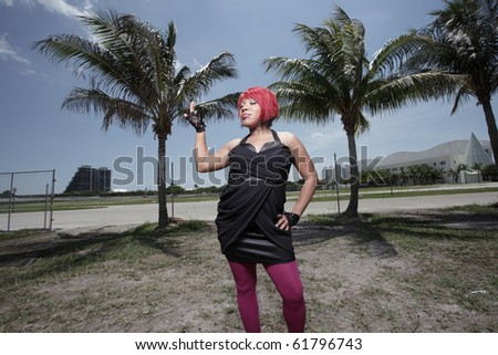 Fashionable young woman posing in an outdoor setting - stock photo
