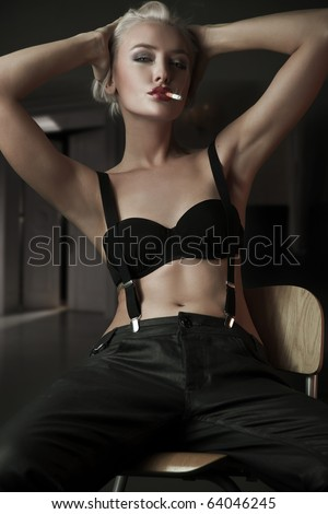 fashionable young woman smoking a cigarette
