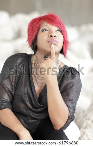 Fashionable young woman thinking - stock photo