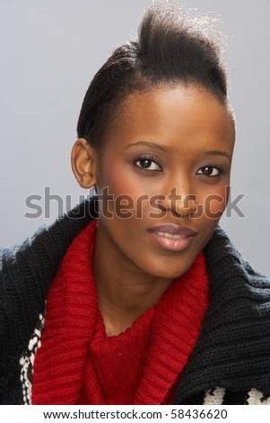 Fashionable Young Woman Wearing Knitwear In Studio