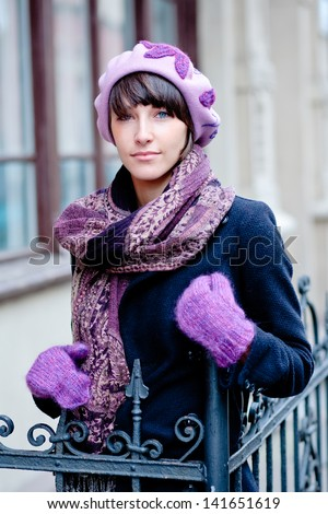 fashionable young woman wearing pink beret and gloves - stock photo