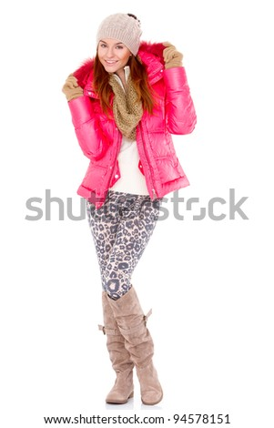 Fashionable young woman wearing winter jacket scarf and cap - stock photo
