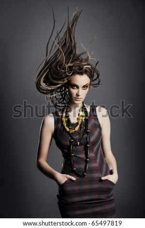 Fashionable young woman with dreadlocks.