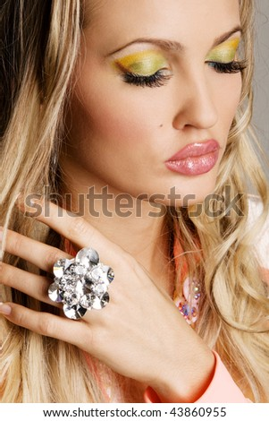 Fashionable young woman with vibrant makeup, face portrait - stock photo