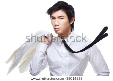 Fashionably stylish, good looking metrosexual Chinese model dressed in all white. Shot with a sense of motion with him flipping jacket over shoulder and tie flying. - stock photo