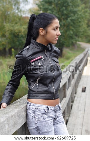 Fashionl girl stay on bridge. More images of this models you can find in my portfolio - stock photo