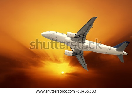 Fast airplane with sunset - stock photo