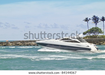 Fast and expensive Luxury  pleasure yacht heading out to sea for some leisure time - stock photo