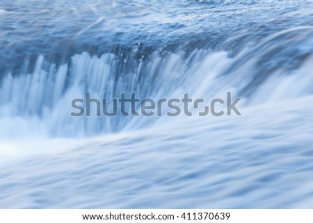 Fast and flowing waterfall  background , long exposure
