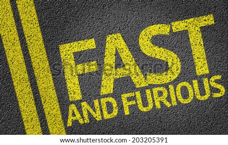 Fast and Furious written on the road - stock photo