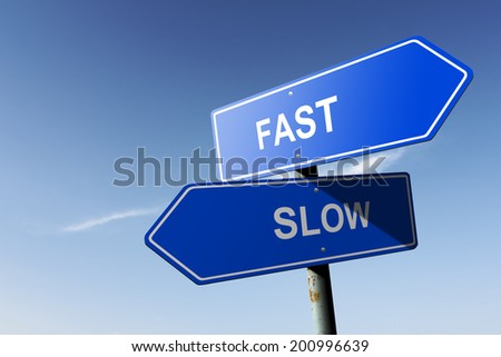 Fast and Slow directions.  Opposite traffic sign. - stock photo
