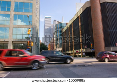Fast automobile traffic moving through downtown city streets. Lots of motion blur. - stock photo