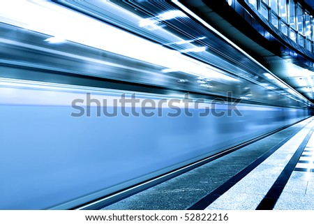 fast blue moving train on underground station