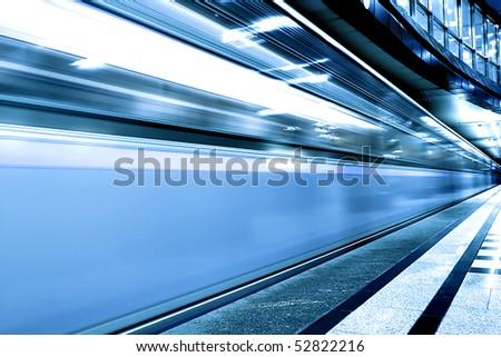 fast blue moving train on underground station - stock photo
