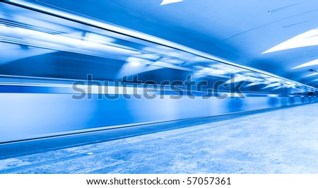 fast blue wide moving train