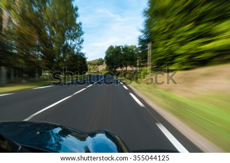 Fast car driving on the country road