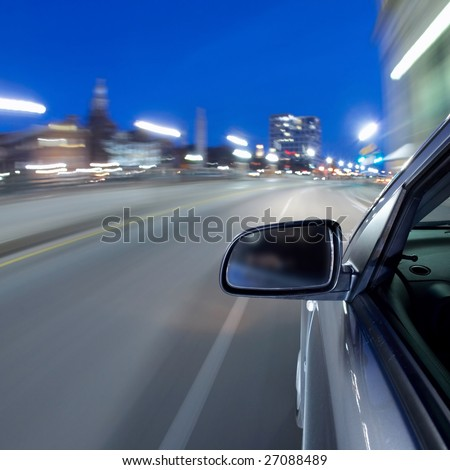 Fast car moving in motion on the highway - stock photo