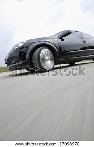 Fast car moving with motion blur - stock photo