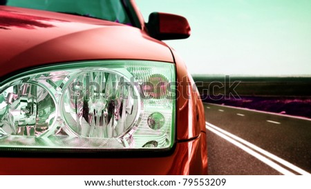 Fast car on the road. - stock photo