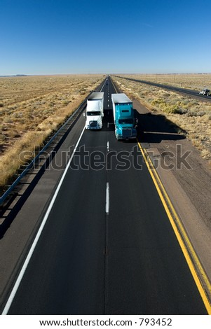 Fast delivery (trucks on American interstate) - stock photo