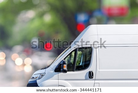Fast delivery, van on city street blured bokeh background - stock photo