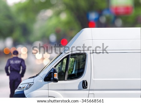 Fast delivery, van on city street  bokeh background - stock photo