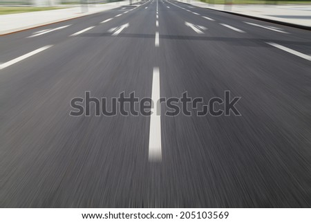 fast drive on asphalt (medial strip) - stock photo