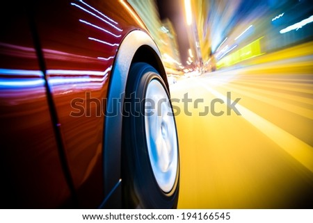 Fast Driving Car Through the City. Long Exposure Photography. Speeding Car Motion Blur