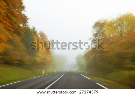 Fast Driving in Fog and low Visibility - stock photo